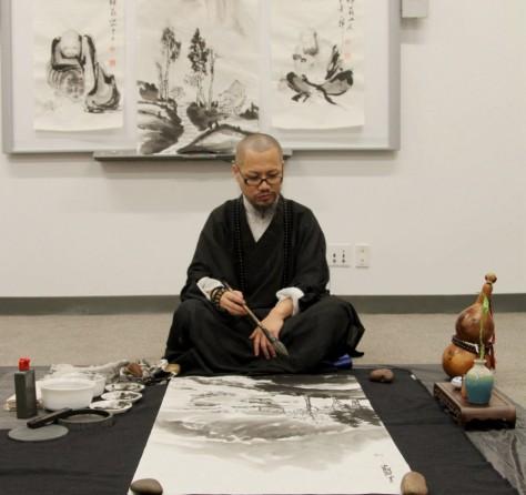 Yixiong GU artists to demo Zen brush painting.